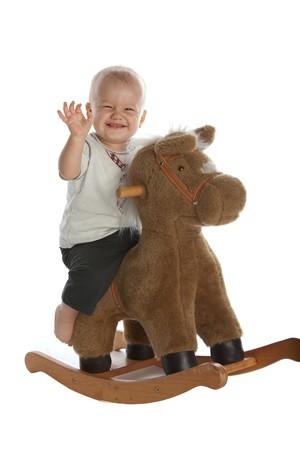 barefoot cowboy: Little Smiling Baby Boy on Rocking Horse