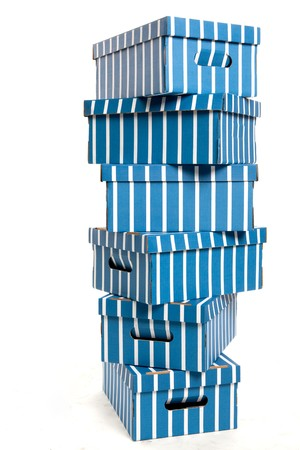 Colourful Cardboard Boxes Stacked on a White Isolated Background Stock Photo