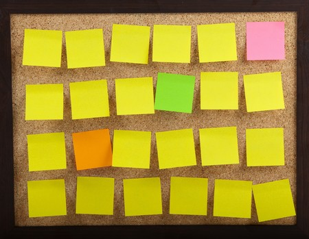 Colourful Notes On Brown Cork Board Stock Photo - 7510742
