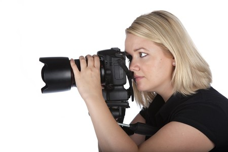 Beautiful Young Female Photographer Taking a Photo with Camera on a Tripod
