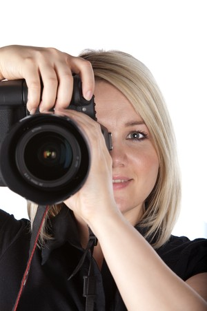 Gorgeous Young Female Photographer Holding Camera on White Isolated Background