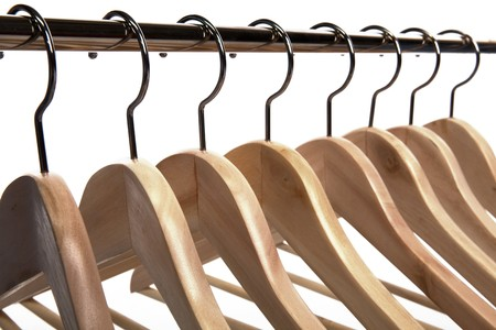 clothing rack: Wooden Clothes Hangers on a White Isolated Background