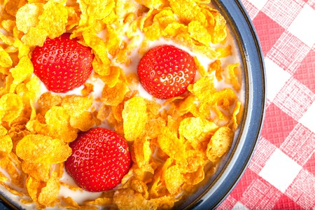 Cereal In A Bowl With Milk And Strawberries photo
