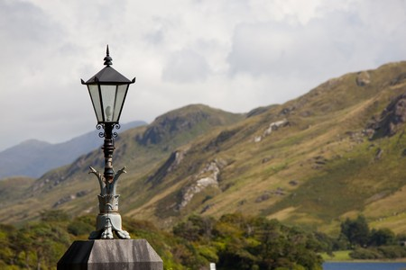 Lantern With Cloudy Sky And Mountains In The Background