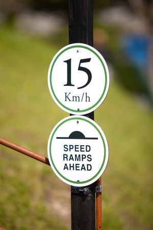 Speedlimit Sign And Ramps Warning On A Pole Stock Photo