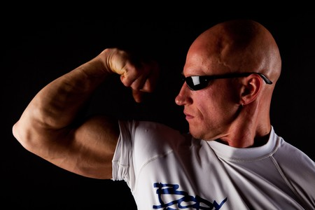 Fit Bodybuilder With Sunglasses On Black Isolated Background