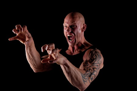 Angry Fit Bodybuilder Screaming On Black Background Stock Photo