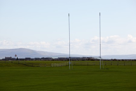 Rugby Goal On Green Grass With Mountains in The Background photo