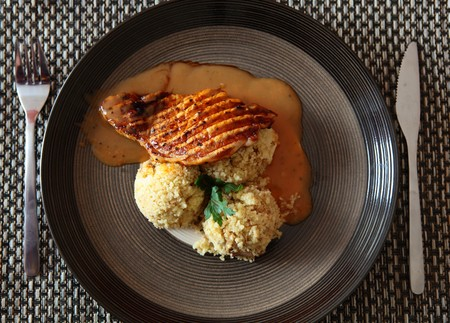 epicurean: Pork With Pepper Sauce and Cous-Cous On a Plate