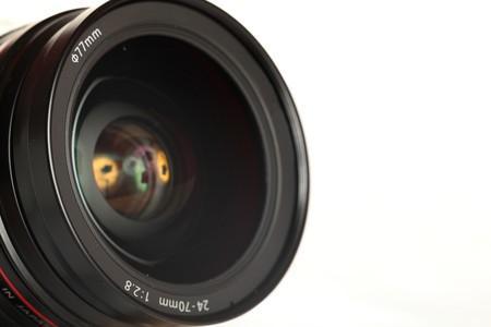 Black Digital SLR Camera Lens on White Isolated Background photo