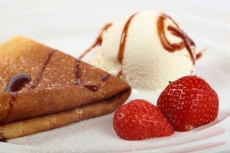 Delicious Pancake With Strawberries And Ice Cream On A Plate