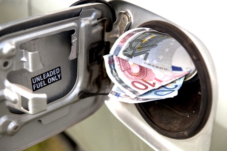 Euro Notes Sticking Out Of A Car Fueltank