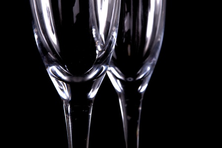 Two Living Crystal Champagne Glasses Isolated On Black