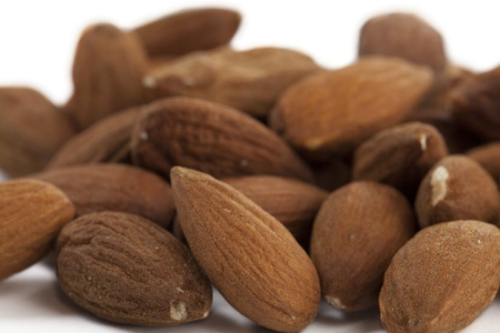 Pile of Almond Nuts on White Isolated Background