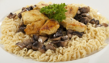 Chicken with Noodles and Mushrooms Isolated on White Background