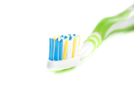 One Green Toothbrush on White Isolated Background Stock Photo