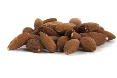 Pile of Almonds Isolated on White Background Stock Photo