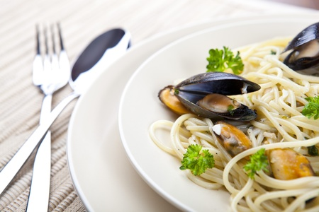 Pasta with Seafood and Green Parsley on a Plate.