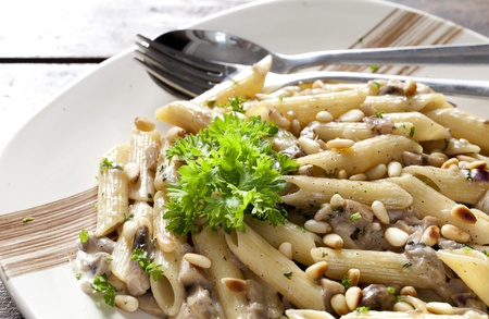 Vegetarian Pasta with Mushrooms and Pine Nuts on a Plate