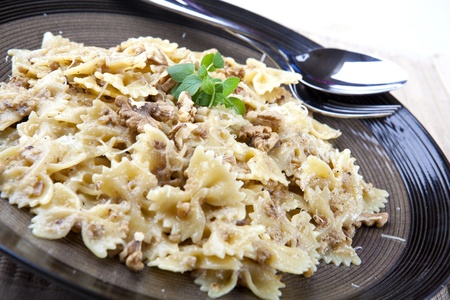 Farafelle in a Walnut Sauce Covered with Parmesan Cheese Stock Photo