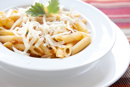 Pasta with Cheese and Parsley on a white Plate
