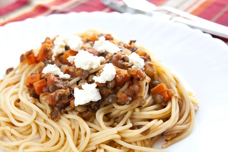 Pasta with Lentil and Feta Sauce on a White Plate