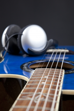 Close Up Details of Classic Blue Guitar with Headphones