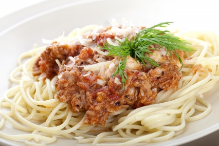 Delicious Spaghetti Bolognese Pasta with Cheese on a Plate Stock Photo