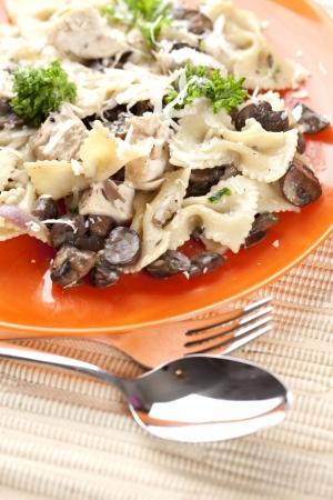 Farafelle Pasta with Mushrooms, Cheese and Parsley on a plate