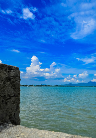 Blue sea and sky with white clouds,