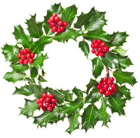 Christmas wreath of nature leaves and berries holly ilex plant isolated on white background  photo