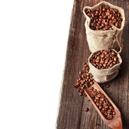 Border of coffee on wooden plank board on white background  photo