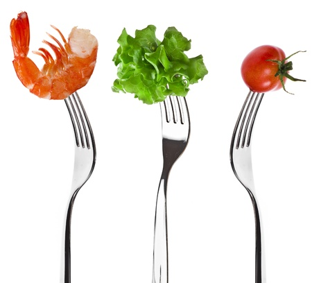 foods on a fork isolated on white background