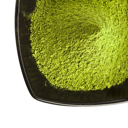 green powder: powdered green tea over a white