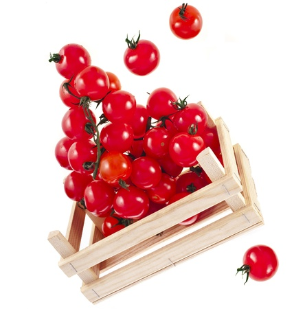 fresh ripe tomatoes in a wooden crate isolate on a white background photo