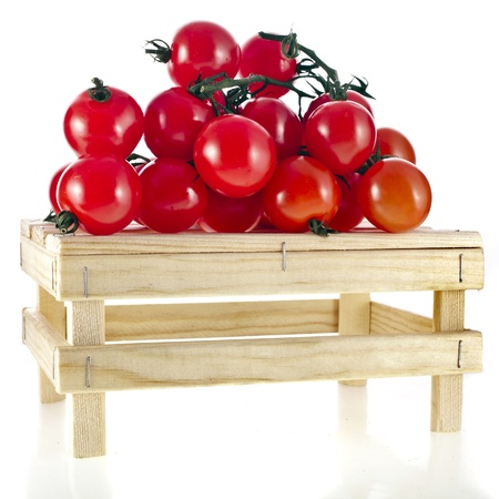 fresh tomatoes in a wooden crate isolate on a white background photo