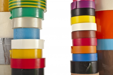 packing tape: Border Frame of Multicolored insulating tapes roll isolated on white background