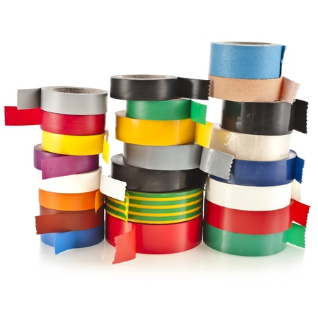 sellotape: Tower of Multicolored insulating tapes roll isolated on white background Stock Photo