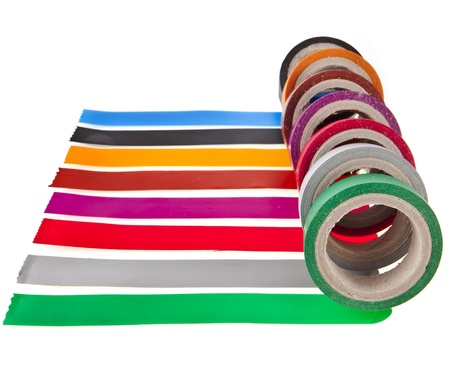 Strips of colourful insulating adhesive tape with roll isolated on white background photo
