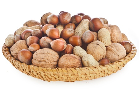 ayurvedic: mix nuts isolated on wooden dish white background Stock Photo