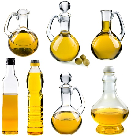 Olive and sunflower oil in the bottles and decanters isolated on white background photo