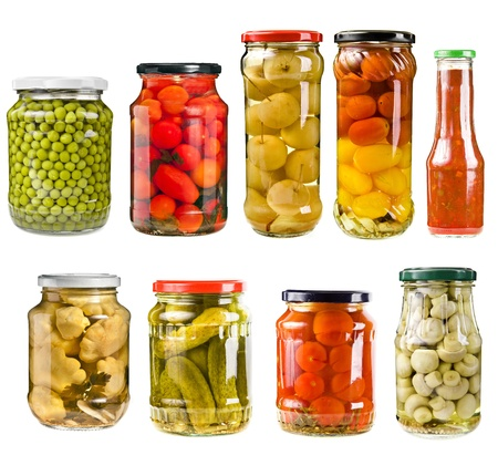 canned peas: canned vegetables in glass jars isolated on white background