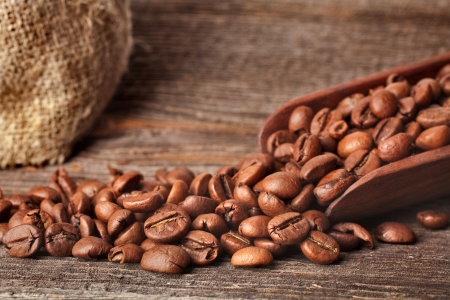Background with coffee beans and wooden scoop photo