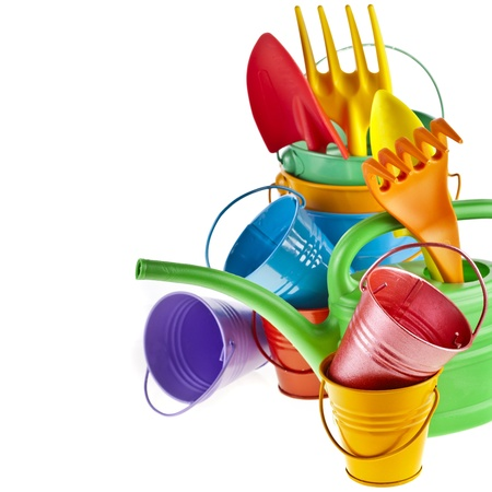 Border of Colorful Gardening Tools : Watering can, bucket, spade over white background Stock Photo