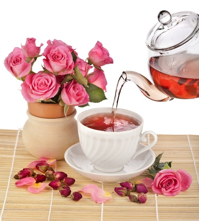 Tea cup with rose bouquet isolated on white