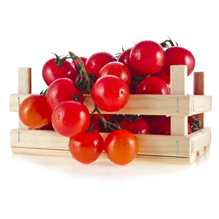 cherry tomatoes: fresh tomatoes in a wooden crate isolate on a white background