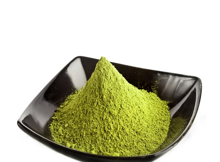 powdered green tea over a white Stock Photo - 17919574