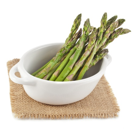 Asparagus in ceramic pot isolated on a white background photo