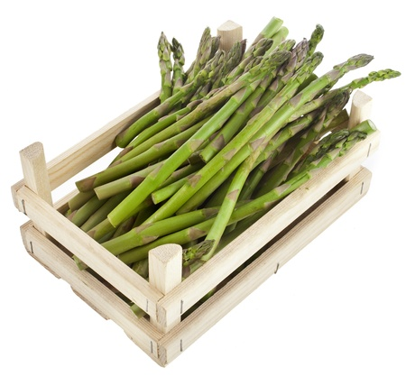 asparagus bunch in wooden crate box isolated on white photo