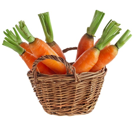 isilated: Carrot vegetables in a wooden basket isilated over white background Stock Photo
